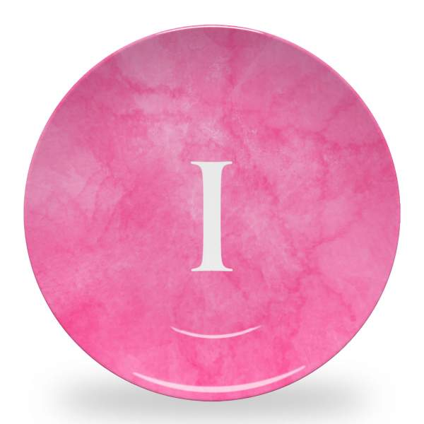 10 inch diameter personalized dinner plate with pink marbled background and initial in roman font