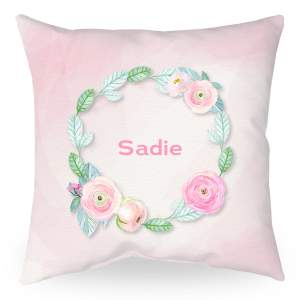 18 inch square personalized throw pillow with pink background, flowers, and name