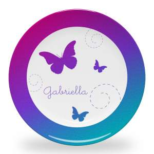 10 inch personalized dinner plate with a moonrise gradient, butterflies, spirals and name in Little Daisy font