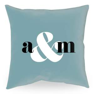 18 inch square personalized throw pillow with two black initials and large white ampersand on a eucalyptus colored background